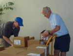 Matt Roney and Lester Brown unloading boxes of Full Planet, Empty Plates.